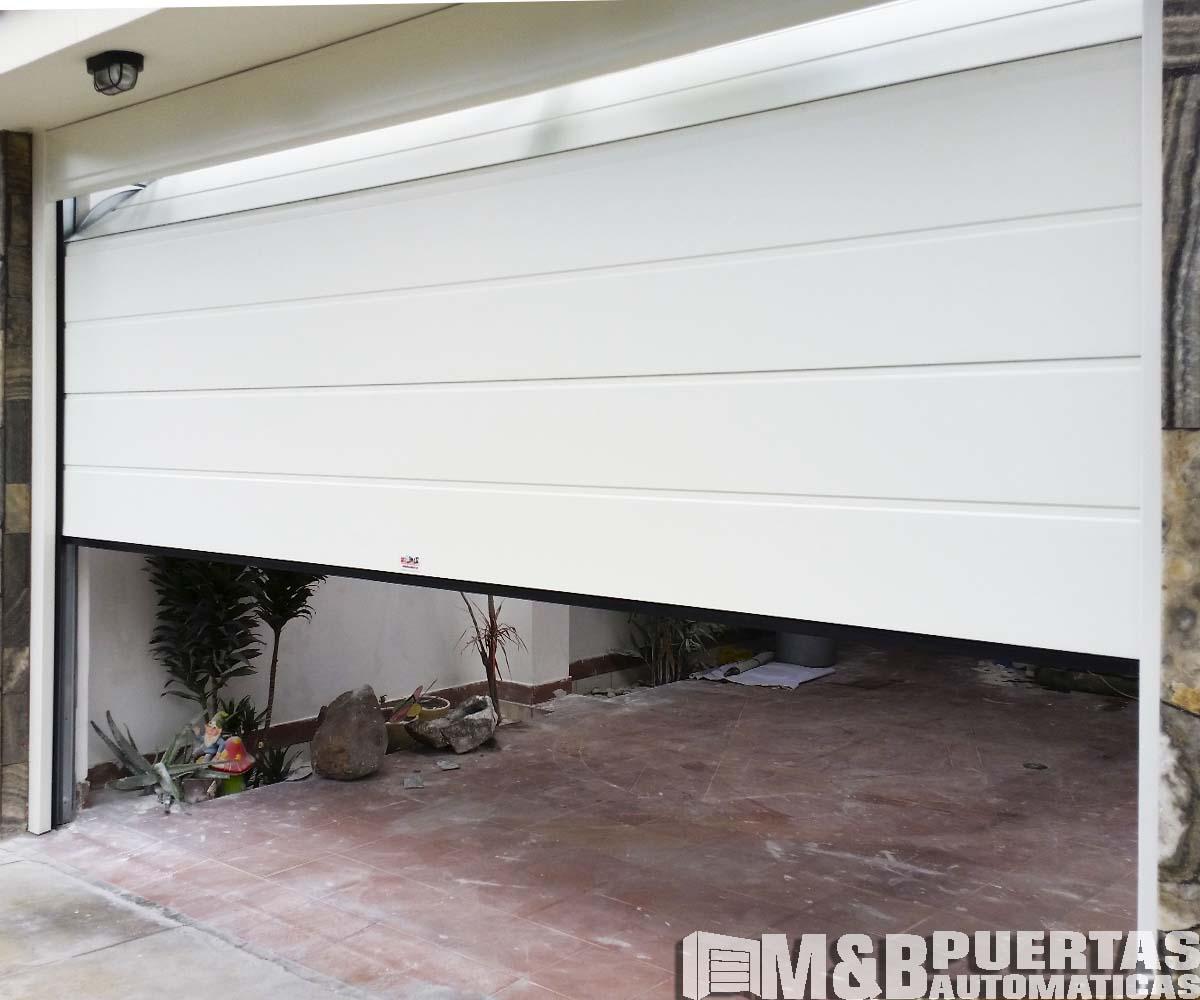Puertas de garaje panel importado blanco - M&B Puertas Automáticas