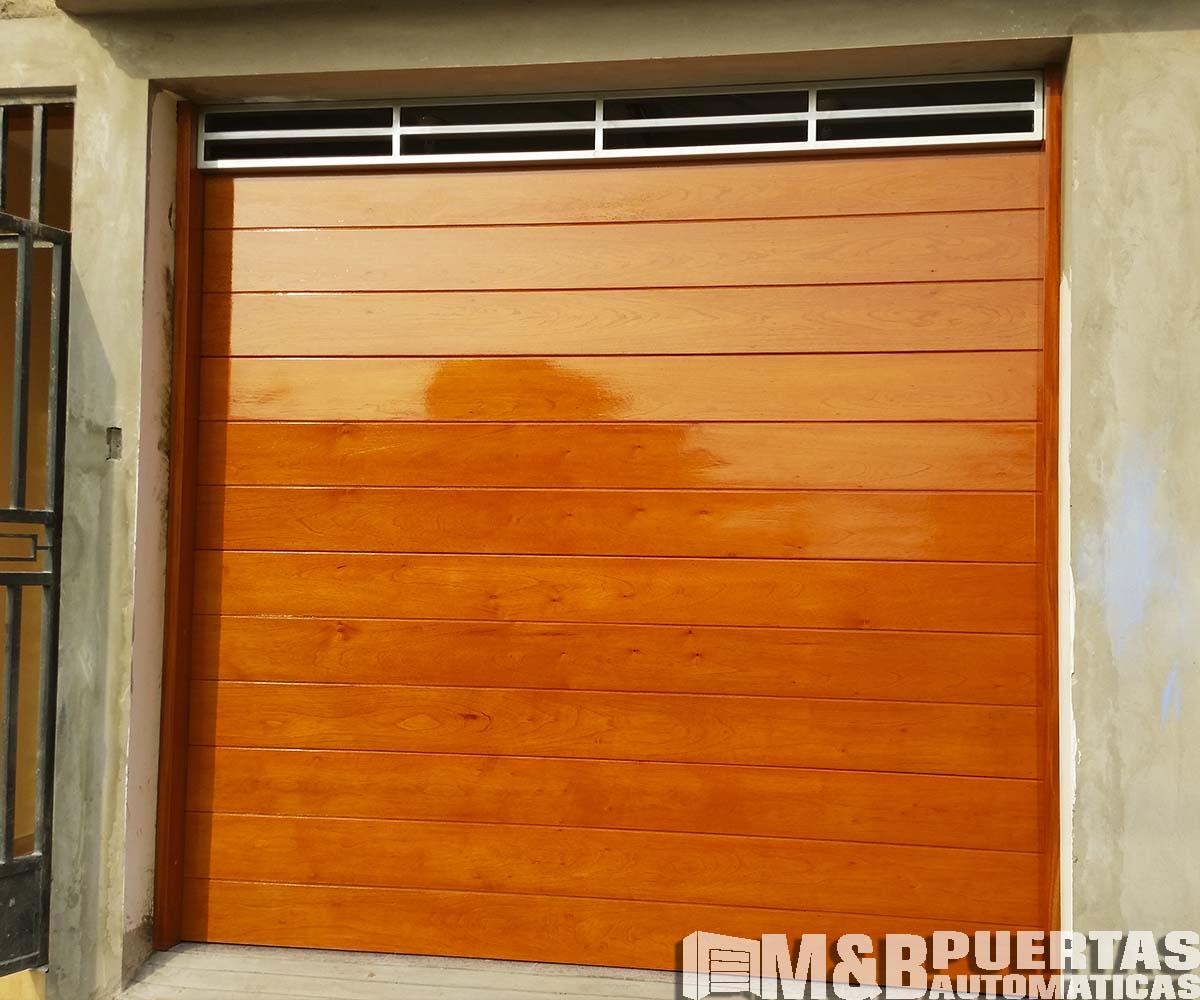 Puertas de garaje con sistema seccional m b puertas for Puertas de garaje de madera