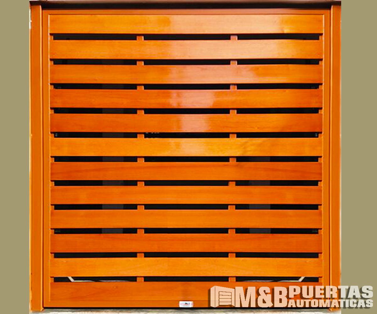 Puertas de garaje en madera tipo reja m b puertas for Tipos de puertas de madera