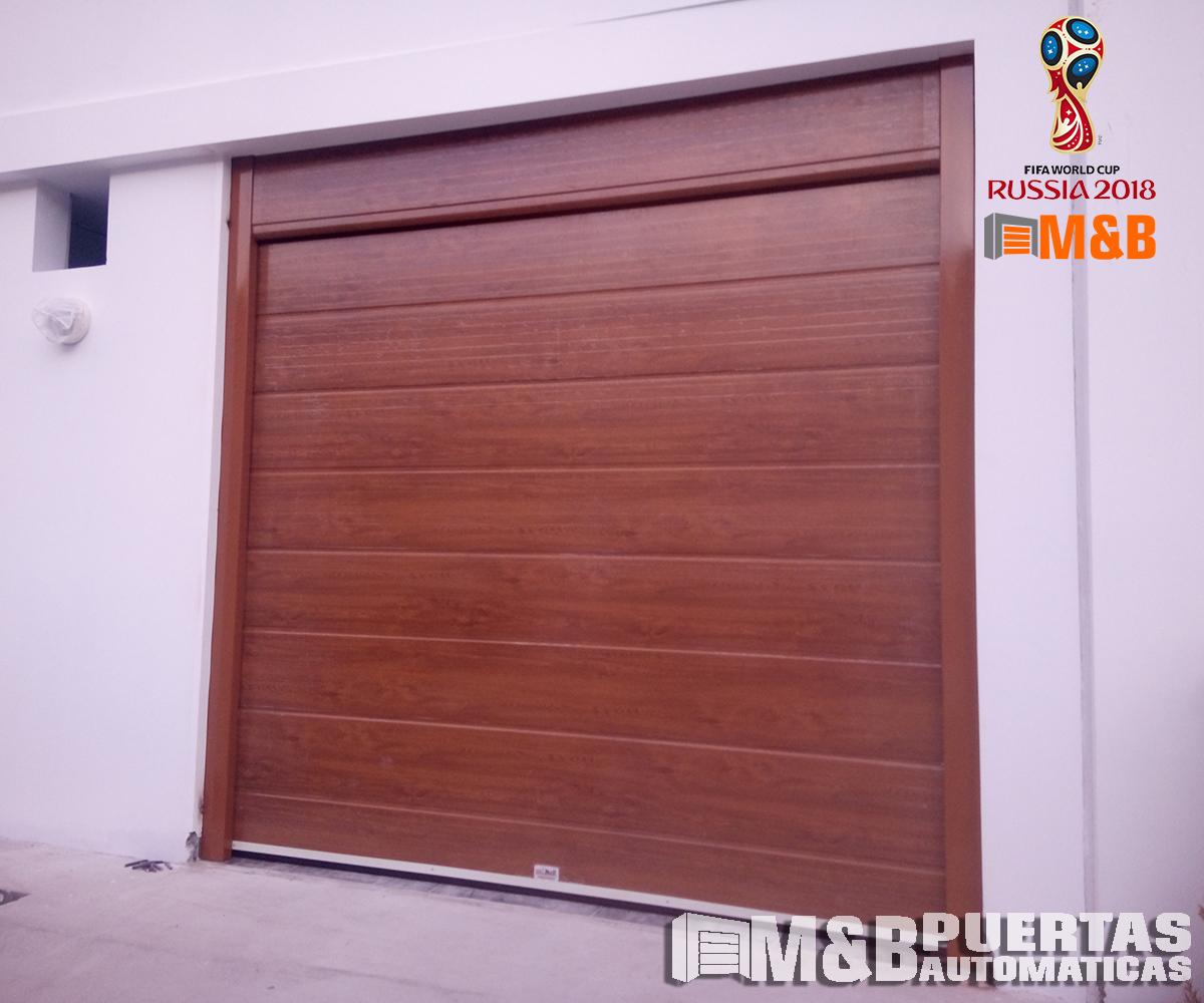 Proyecto puerta seccional de panel madera en alto bujama for Puertas de garaje de madera