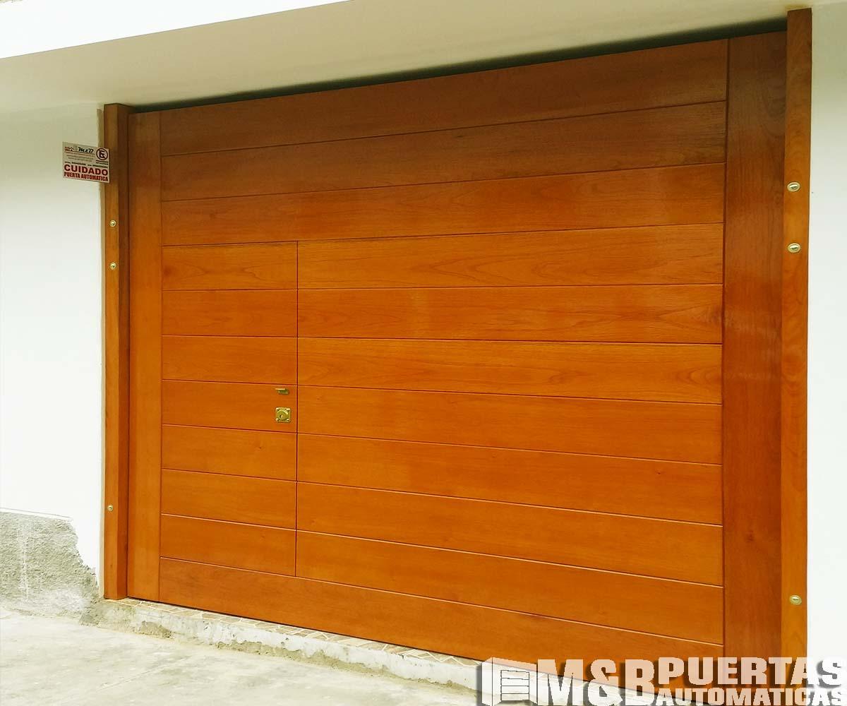 Puertas de garaje con puerta de postigo m b puertas - Proyecto puerta de garaje ...